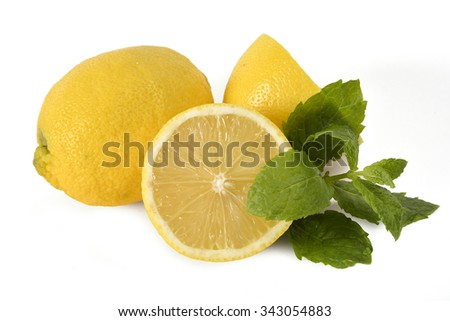 Sliced lemons with a couple of mint leaves isolated