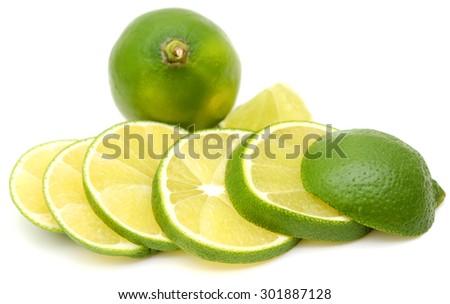 Sliced lime fruit isolated on white background - stock photo