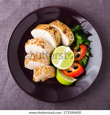 Sliced lime pork tenderloin on dark canvas background top view. Healthy food. - stock photo