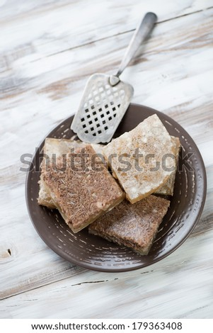 Sliced meat jelly on a plate, view from above - stock photo