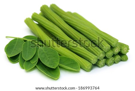 Sliced Moringa Oleifera or sonjna with leaves over white background - stock photo