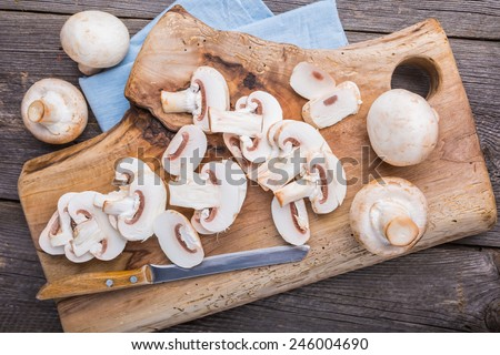 Sliced mushrooms on a cutting board - stock photo