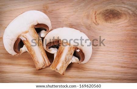 sliced portabella mushrooms  Sliced Mushrooms over wooden background.