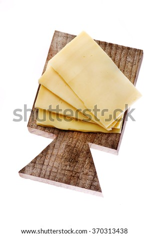 Sliced of cheese on wooden cutting board isolated on a white background. - stock photo