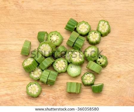 sliced okras with wooden board - stock photo