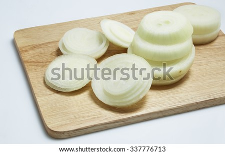 Sliced onion ring isolated on wooden board on white background