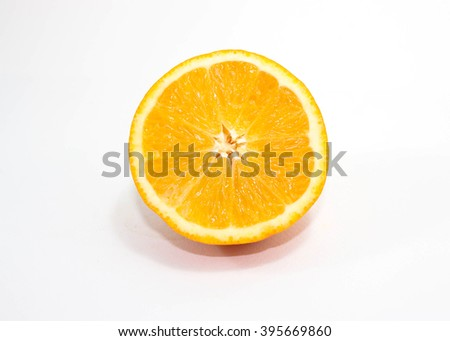 Sliced orange fruit with leaves isolated on white background