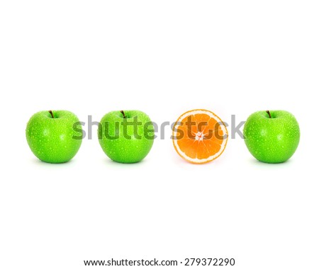sliced orange place on white background among green apple with water droplet , unique or different concept - stock photo