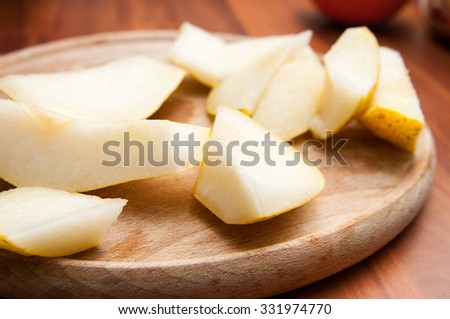 Sliced pear on a wooden background