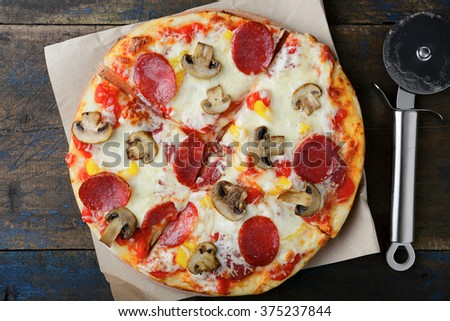 Sliced Pepperoni Pizza with mushrooms. Traditional italian food