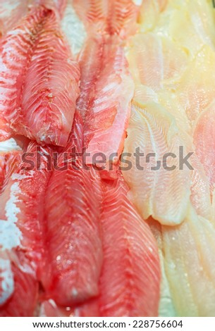 Sliced pieces of different fish on the market. - stock photo