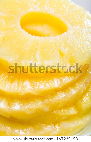 Sliced pineapple. Canned fruits. Macro - stock photo