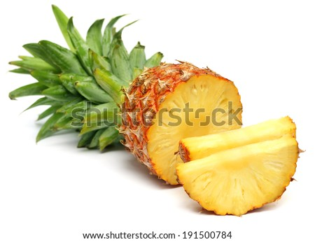 Sliced pineapple over white background - stock photo