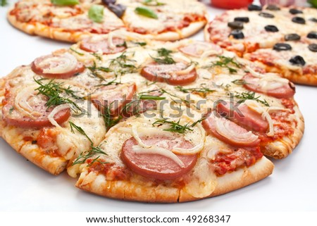 sliced pizza with sausage and onion - stock photo