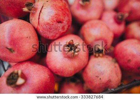 sliced pomegranate fruits lie on the counter street market in Istanbul - stock photo