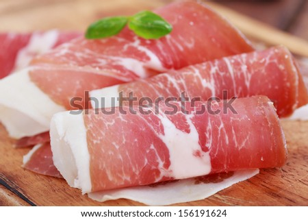 sliced prosciutto - stock photo