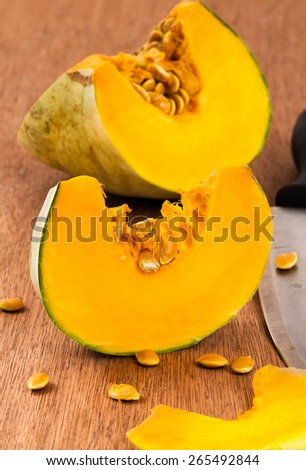 sliced pumpkin with knife  - stock photo