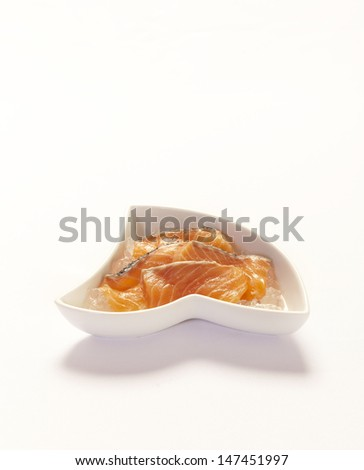 Sliced raw fatty salmon isolated on white background