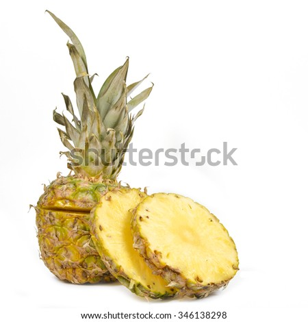 Sliced raw pineapple isolated on white background