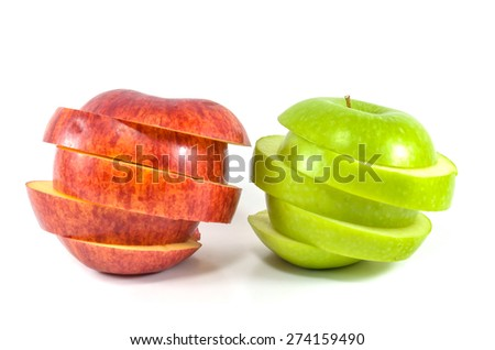 Sliced red and green apple on white background - stock photo