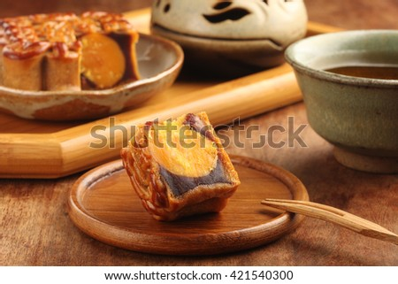 Sliced red bean paste moon cake with yolk
