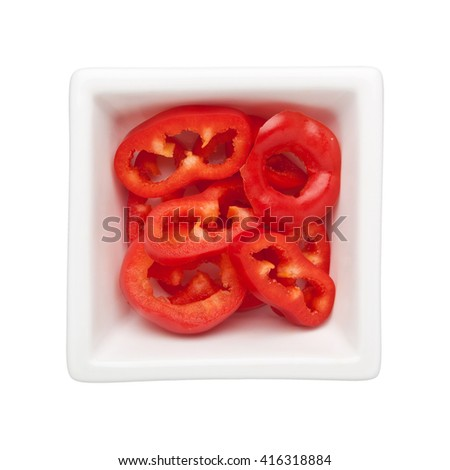 Sliced red bell pepper in a square bowl isolated on white background - stock photo