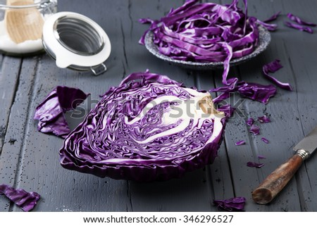 sliced red cabbage red cabbage on old wooden table with knife