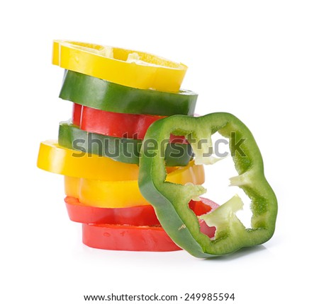 Sliced red yellow green pepper isolated on white - stock photo