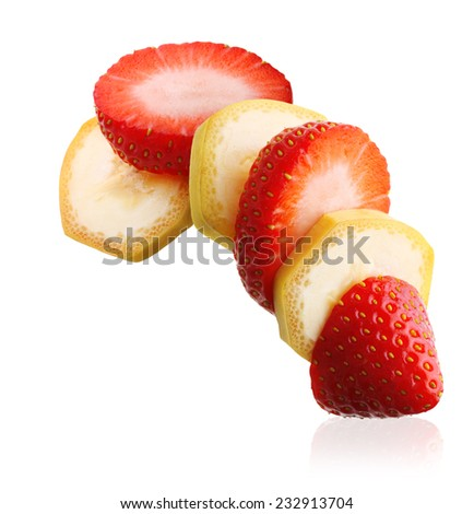 Sliced ripe banana and berry strawberry isolated on white background - stock photo
