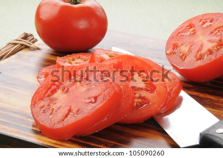 Sliced ripe tomatoes on a cutting board