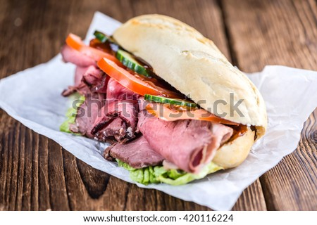 Sliced Roast Beef on a sandwich (selective focus; close-up shot)