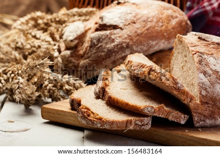 Sliced rye bread on wooden table  - stock photo