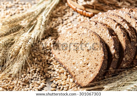 Sliced rye bread with seeds on a wooden table