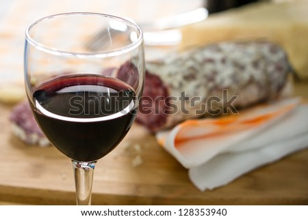 sliced �¢??�¢??salami and glass of wine on the table - stock photo