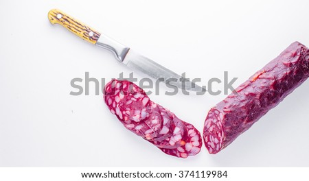 sliced salami isolated on a white background - stock photo