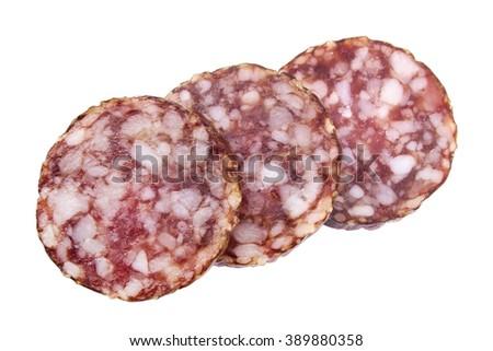 Sliced salami slices closeup isolated on white - stock photo
