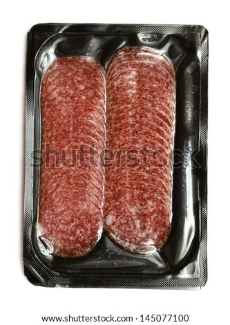 Sliced sausage in the package isolated on a white background