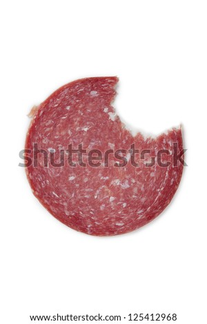 Sliced sausage with small bite - stock photo