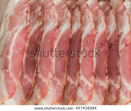 Sliced smoked bacon / background
