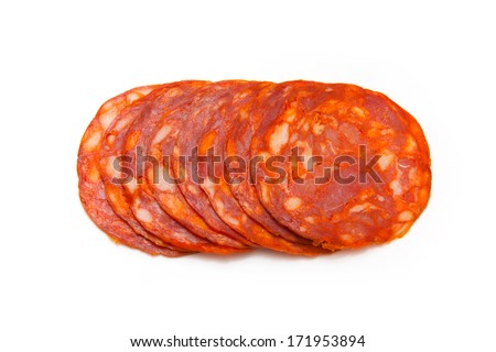 Sliced Spanish chorizo sausage isolated on a white studio background. - stock photo