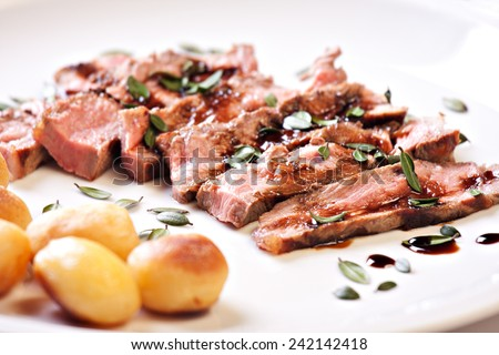 Sliced steak with potatoes