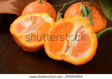 Sliced Sumo oranges, a wrinkly sweet orange that is a cross between a Mandarin and California navel orange - stock photo