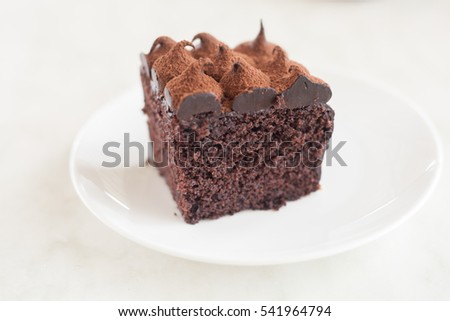 sliced tasty chocolate cake on a white plate