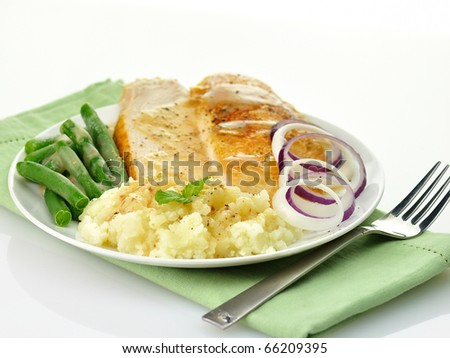 sliced turkey with mashed potatoes and green beans - stock photo