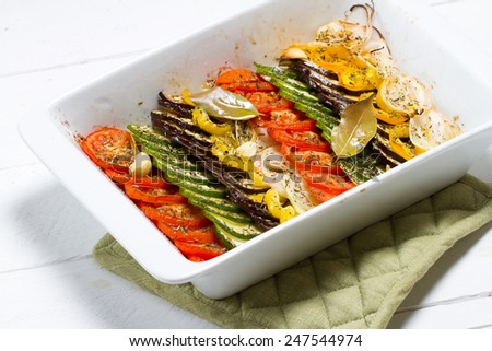 Sliced vegetables baked with herbs, olive oil and bay leaves