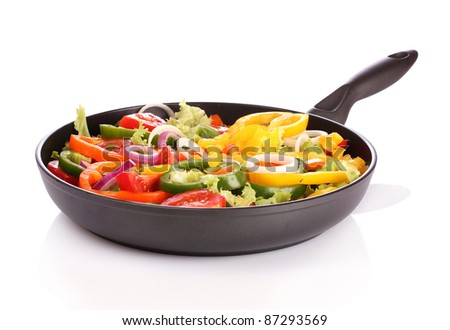 sliced ??vegetables in a pan isolated on white