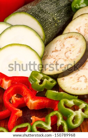 Sliced vegetables on a wooden cutting table