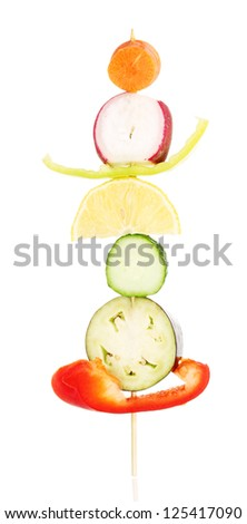 Sliced vegetables on wooden pick isolated on white