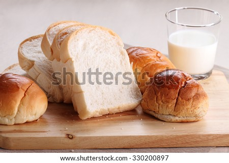 Sliced white bread and buns