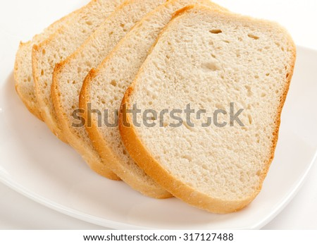 Sliced white bread on a plate - stock photo